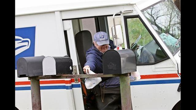 Letter carriers picking up food donations
