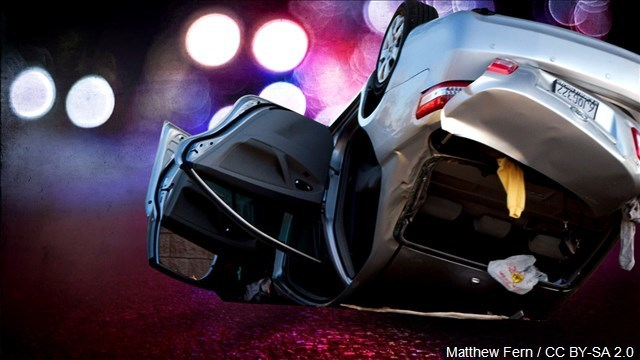 Driver hospitalized after rolling his vehicle in Sands Township