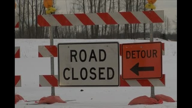 Wind, now flooding causes Lakeshore Blvd. to close